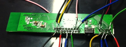 Bluetooth controller with first wires soldered onto it.